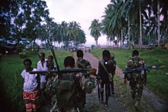 PNG forces patrol villages with their BRF allies.