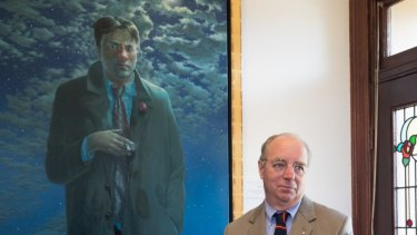 Tim Storrier, last year's winner of the Doug Moran National Portrait Prize, with his work The Lunar Savant.