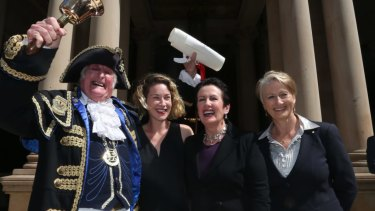 Town crier Graham Keating, Jess Miller, Sydney lord mayor Clover Moore and Professor Kerryn Phelps on the steps of Town Hall at the proclamation of the 2016 council.