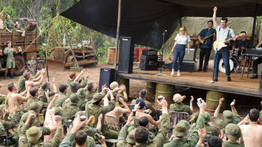 Little Pattie (Emma Dougall) and Col Joye (Geoffrey Winter) perform for the troops at Nui Dat Base in Danger Close: The Battle Of Long Tan.