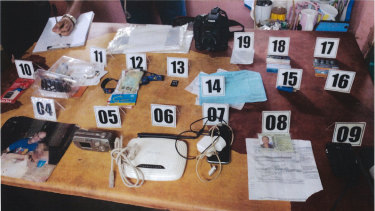 Exhibits seized from the home in the Philippines, including the photo.