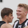 Pies hang on for narrow win over Blues