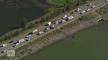 A wider aerial view of the scene on Beaudesert-Boonah Road and in Wyaralong Dam.