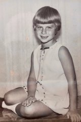 """Deborah aged 6. Her seamstress mum made all her childhood clothes and was the """"master of pinafores""""."""