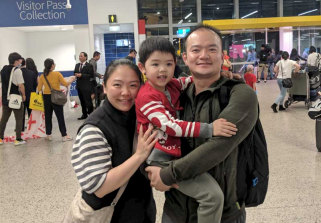 Song Xiao is reunited with his wife and young son at Melbourne Airport after spending time in coronavirus quarantine on Christmas Island.