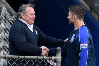 Costly shake? Bulldogs legend Terry Lamb greets Kieran Foran before training on Thursday.