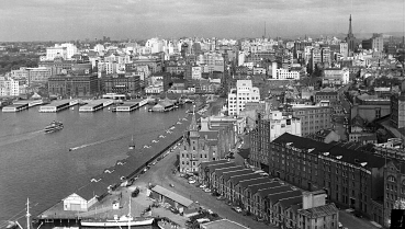 """THEN Circular Quay in the 1950s. Often regarded as the """"Gateway to Sydney"""" it is located in Sydney Cove – site of the First Fleet's initial landing in Port Jackson in 1788."""
