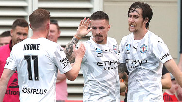 Strike force: Jamie Maclaren was on target again for Melbourne City, firing in a treble against Brisbane Roar.