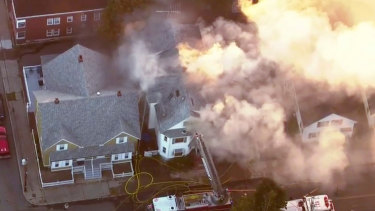 Firefighters battle a large structure fire in Lawrence, Massachusetts, a suburb of Boston.