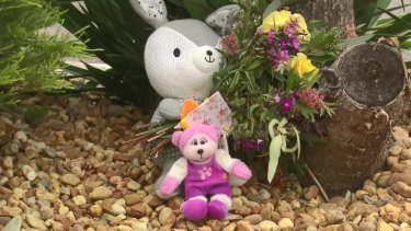 Flowers and soft toys were left at the scene on Tuesday.