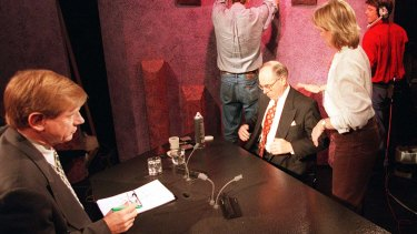 O'Brien (with green pen) and Howard prepare for an interview for <i>The 7.30 Report</i> on the 1996 budget.