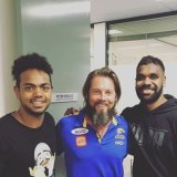 Ben Cousins with West Coast Eagle player Willie Rioli.