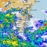 Two dead as heavy rain and storms cause commuter chaos in Sydney