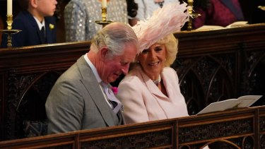 Britain's Prince Charles and Camilla, the Duchess of Cornwall, smile during the wedding ceremony of Prince Harry and Meghan Markle.