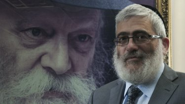 'Diamond' Joe Gutnick in front of a painting of Rabbi Menachem Mendel Schneerson, in his Melbourne office in 2013.