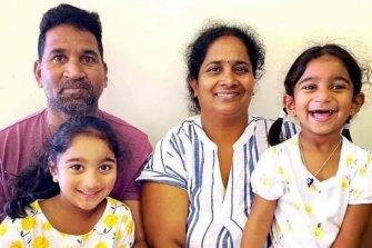 Nades and Priya Murugappan with their daughters Kopika and Tharnicaa.