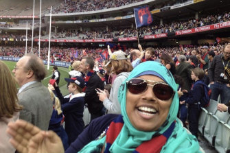 Demons fan and footy tragic Rana Hussain enjoying a game at the 'G.