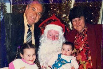 Ilias, his wife Aristea and daughters Eleni and Evagelia with Santa Claus.