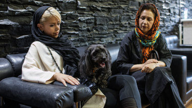 Mandana and her mother with Mandana's 4-year-old dog at the vet clinic in Tehran, Iran.