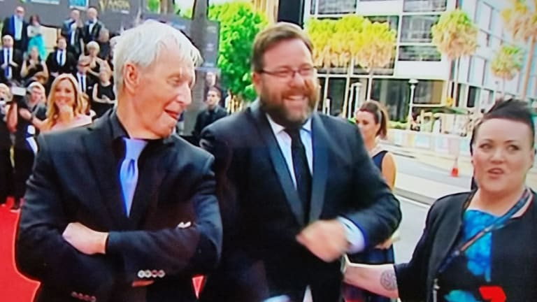 In happier times: Deb Fryers on the red carpet with Paul Hogan and Shane Jacobson in December 2016.