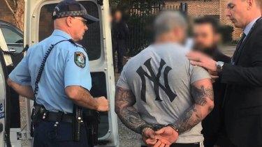 Police arrest Troy Fornaciari.