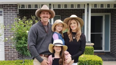 Melissa Tague, who was diagnosed with melanoma, with her husband Ryan and daughters Emily and Sophie.