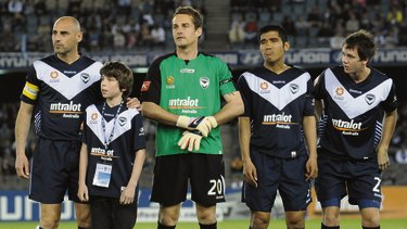 Hamish beside Kevin Muscat, before the start of the match against Qatar in Melbourne a decade ago.