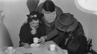 A photo taken in 1938 of teacup readings in Brisbane were illegal under Queensland's criminal code so they were done in secret.