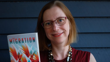 Queensland author Dr Helen Marshall with her book The Migration, which is expected to be turned into a television series.