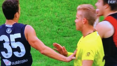 Touch off: Carlton's Ed Curnow makes physical contact with an umpire in Saturday's match against Essendon.