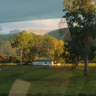 The bucolic view of the hills near Gloucester is reflected in the windows of the XPT train.