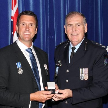 Dan Purdie receives a policing award during his time in the police service.