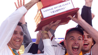 Wollongong Wolves coach Nick Theodorokopoulos and captain Matt Horsley with the winning trophy after defeating Perth Glory in the 2000 NSL grand final.