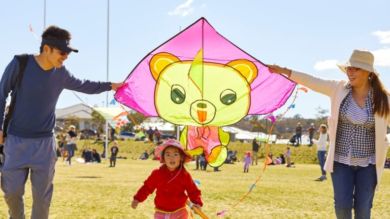 Rui Man, Cherie He, 2, and Xin He enjoy the kites at Flying High in Googong.