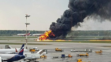 Smoke rises from a fire on a plane at Moscow's Sheremetyevo airport on Sunday.