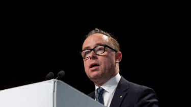 Alan Joyce is confident that Qantas will have a strong second half after it was hit by a $416 million spike in fuel costs in the six months to December.
