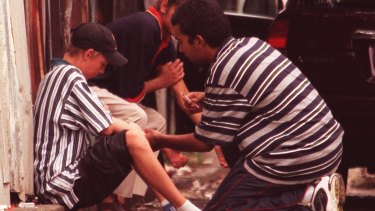 Heroin users on the footpath in Redfern in 1999.