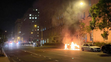 A car on fire one block from the White House as Lafayette Square protests escalate.