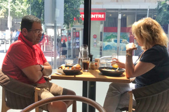 A surveillance photo taken by IBAC investigators of councillor Sam Aziz meeting former Liberal Party MP Lorraine Wreford in a city cafe. She later gave him cash she acknowledged was a bribe.