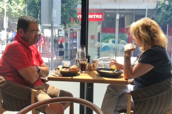 Surveillance photo of Sam Aziz meeting former Liberal Party MP Lorraine Wreford in a city cafe.