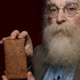 Dr Irving Finkel with the 4000-year-old cuneiform clay tablet telling the story of Noah and the Ark.