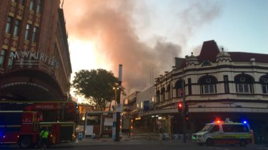 Firefighters respond to the blaze in Brunswick Street Mall, Fortitude Valley.