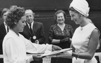Evonne Goolagong is presented with the Venus Rosewater Dish after winning Wimbledon in 1971.