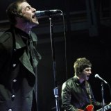Liam and Noel Gallagher on stage together just before Oasis split in 2009.