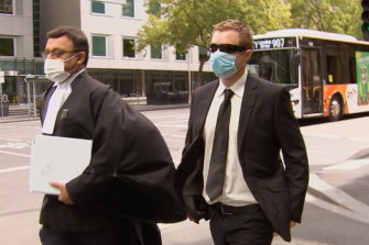 Graeme Walter (right) leaves the County Court on Thursday.