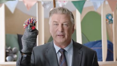 Hollywood actor Alec Baldwin, with his sock puppet, in the eToro ad.