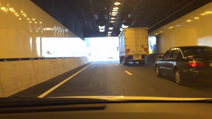 Cyclist illegally entered Legacy Way tunnel, then tried to climb his way out