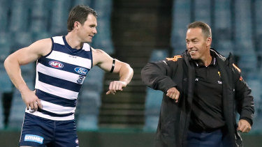 Pandemic protocols: Patrick Dangerfield in his 350th AFL game bumps elbows with Hawks coach Alastair Clarkson.