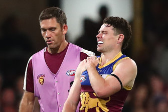 Lachie Neale leaves the field after hurting his shoulder earlier this season