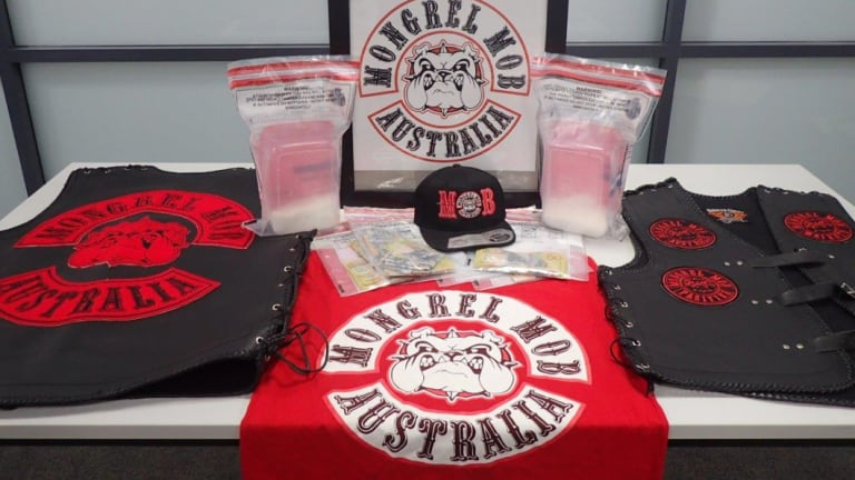 The seized drugs on display next to Mongrel Mob paraphernalia.